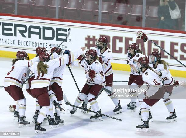Boston College Eagles players swarm teammate Toni Ann Miano after her gamewinning goal as they defeated Boston University 43 in overtime Boston...