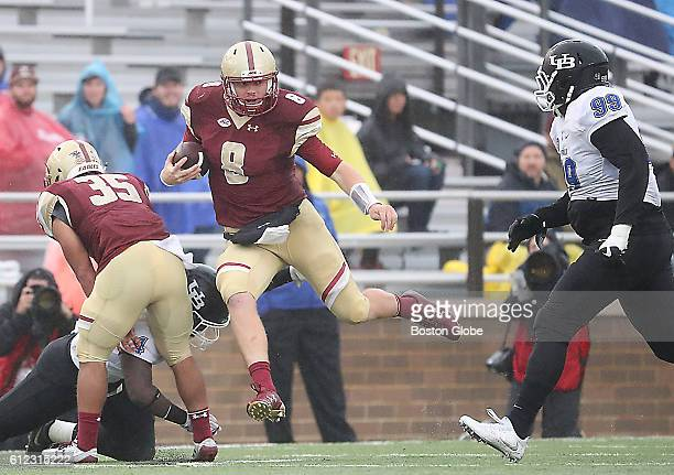 Boston College Eagles qarterback Patrick Towles looks for running room against the Buffalo Bulls during second half action at Alumni Stadium at...