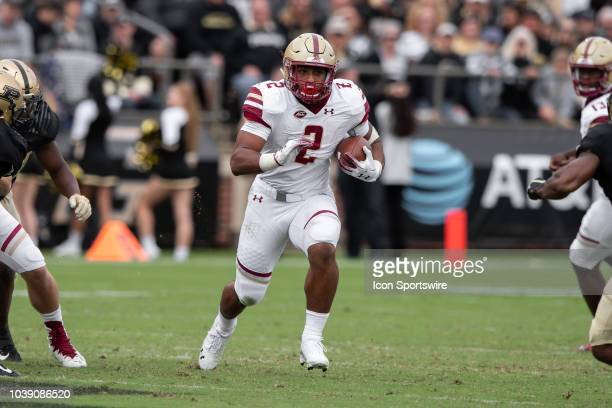 Boston College Eagles running back AJ Dillon breaks through a hole in the line during the college football game between the Purdue Boilermakers and...