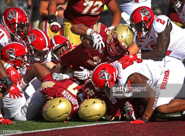 Boston College Eagles running back AJ Dillon plunges over the goal line for his first touchdown of the game to give the Eagles a 303 lead during the...