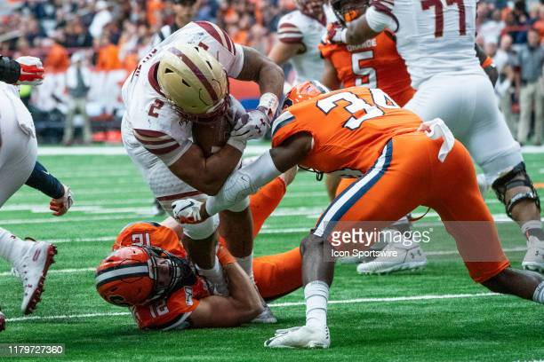 Boston College Eagles Running Back AJ Dillon runs with the ball and is stopped shot of the end zone by Syracuse Orange Linebacker Andrew Armstrong...