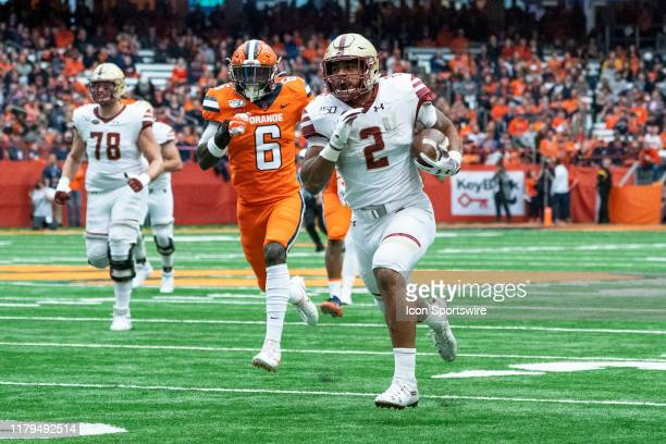Boston College Eagles Running Back AJ Dillon runs with the ball for a touchdown with Syracuse Orange Defensive Back Trill Williams in pursuit during...