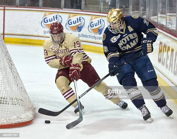 Boston College Eagles Ryan Fitzgerald battles with Norte Dame Fighting Irish Stephen Johns for control of the puck during first period action of the...