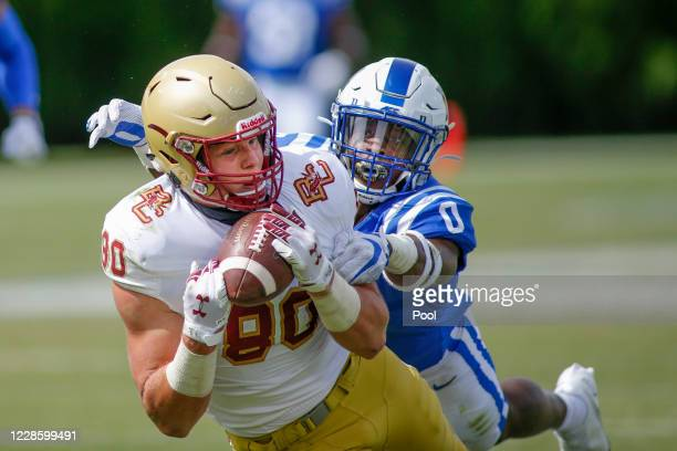 Boston College Eagles tight end Hunter Long (80 catches a pass against Duke Blue Devils safety Marquis Waters in the fourth quarter at Wallace Wade...