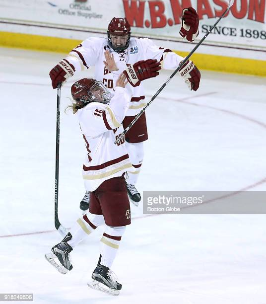 Boston College Eagles' Toni Ann Miano throws off her gloves to celebrate her gamewinning goal as teammate Daryl Watts joins in after they defeated...