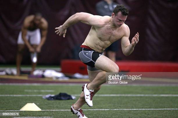 Boston College Eagles wide receiver Charlie Callinan works out during Boston College's pro day at Alumni Stadium in Boston MA on March 21 2018