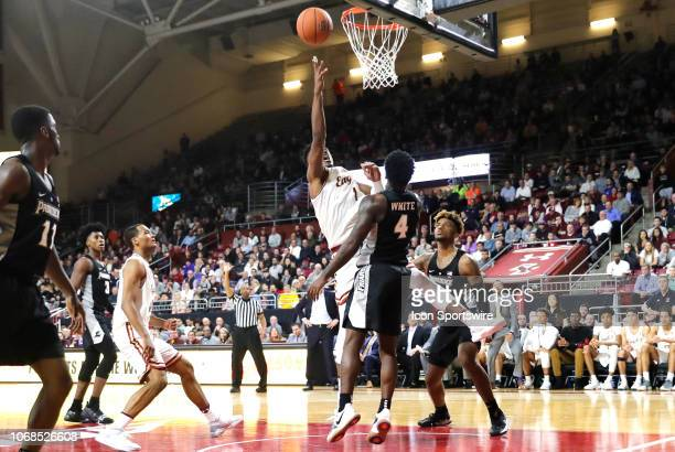 Boston College forward Jairus Hamilton puts up a shot on Providence Friars guard Maliek White during a game between the Boston College Eagles and the...