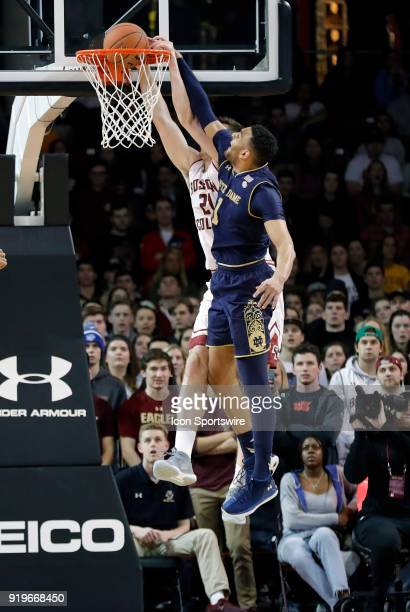 Boston College forward Nik Popovic beats Notre Dame Fighting Irish forward Austin Torres to the hoop for a dunk during an ACC game between the Boston...