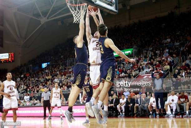 Boston College forward Nik Popovic gets trapped between Notre Dame Fighting Irish forward John Mooney and Notre Dame Fighting Irish guard Nikola...