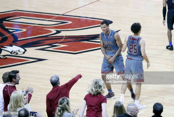 Boston College forward Steffon Mitchell celebrates a time out late with the fans during a game between the Boston College Eagles and the Duke...