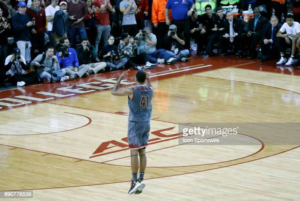 Boston College forward Steffon Mitchell gets the fans pumped up through a time out during a game between the Boston College Eagles and the Duke...