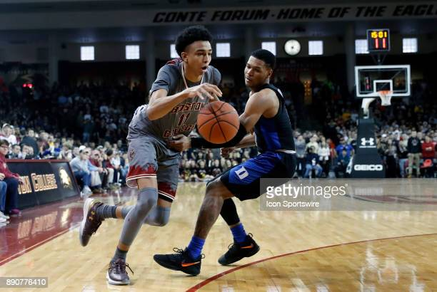 Boston College forward Vin Baker Jr drives past Duke Blue Devils guard Trevon Duval during a game between the Boston College Eagles and the Duke...