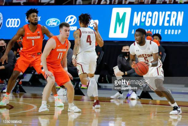 Boston College guard Jay Heath moves past Syracuse Orange guard Joseph Girard III during a game between the Boston College Eagles and the Syracuse...