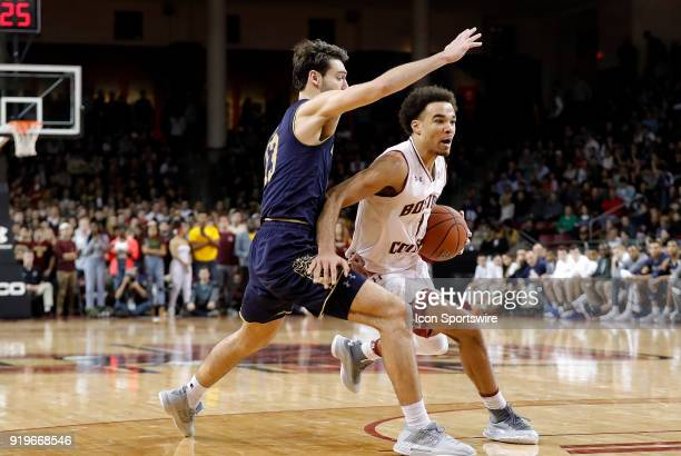 Boston College guard Jerome Robinson drives around Notre Dame Fighting Irish guard Nikola Djogo during an ACC game between the Boston College Eagles...