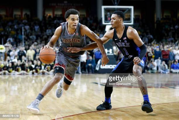 Boston College guard Jerome Robinson drives past Duke Blue Devils guard Trevon Duval during a game between the Boston College Eagles and the Duke...