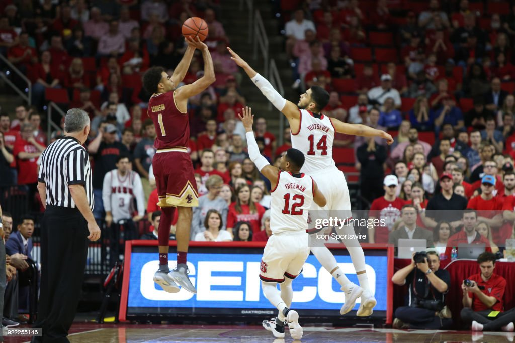 Boston College guard Jerome Robinson (1) shoots the ball over NC State center Omer Yurtseven (14) during the game between the Boston College Eagles and the NC State Wolfpack at PNC Arena on February 20, 2018 in Raleigh, NC.