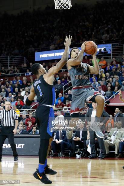 Boston College guard Jerome Robinson takes it to the hoop guarded by Duke Blue Devils guard Trevon Duval during a game between the Boston College...