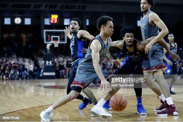 Boston College guard Jordan Chatman gets a lane as Boston College center Johncarlos Reyes sets a pick on Duke Blue Devils forward Marvin Bagley III...