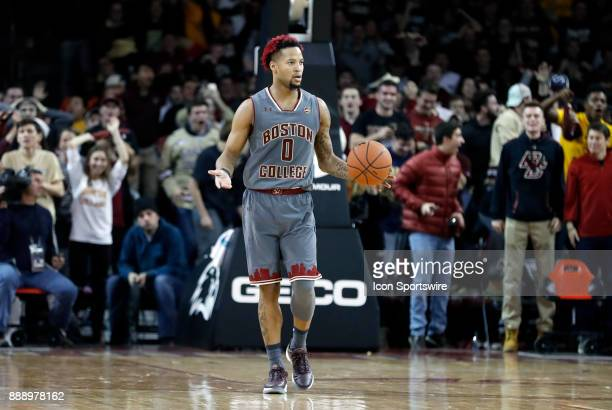 Boston College guard Ky Bowman asks for help late as the students get set to rush the court during a game between the Boston College Eagles and the...