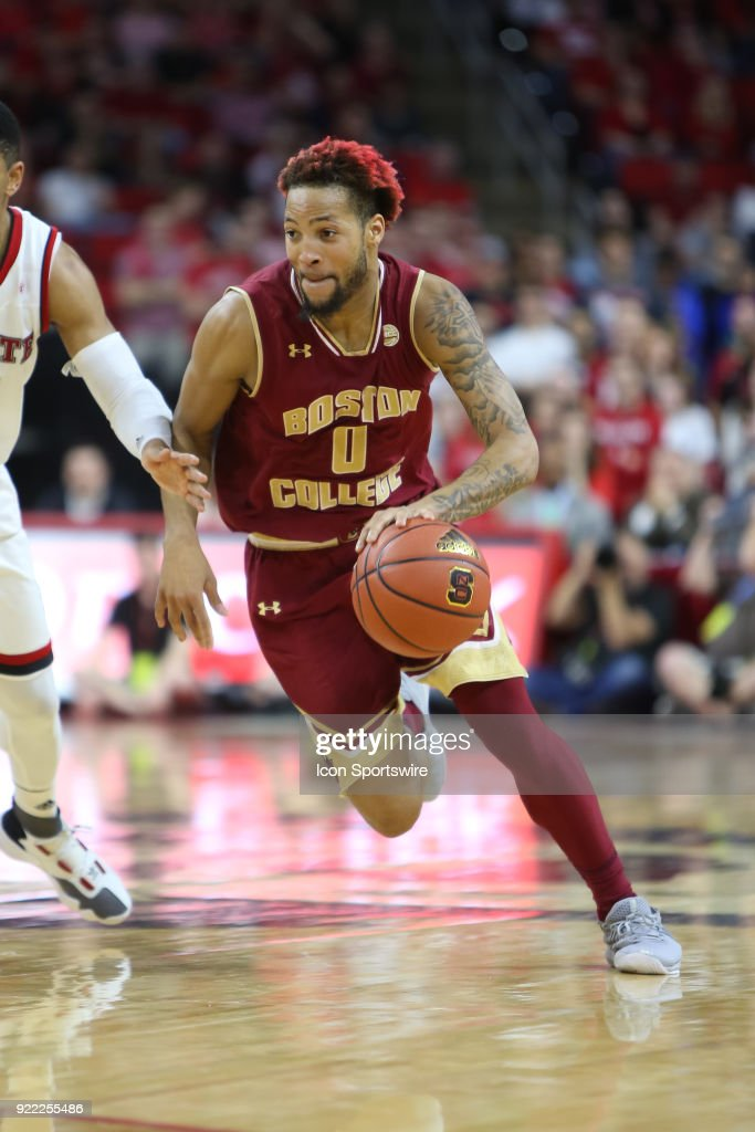 Boston College guard Ky Bowman (0) dribbles past the NC State defender during the game between the Boston College Eagles and the NC State Wolfpack at PNC Arena on February 20, 2018 in Raleigh, NC. The Pack won 82-66.