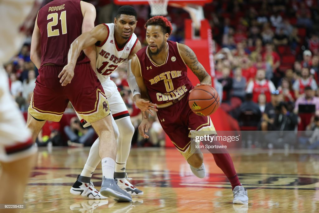 Boston College guard Ky Bowman (0) dribbles the ball past the NC State defender during the game between the Boston College Eagles and the NC State Wolfpack at PNC Arena on February 20, 2018 in Raleigh, NC. The Pack won 82-66.