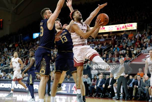 Boston College guard Ky Bowman gets past Notre Dame Fighting Irish guard Nikola Djogo and Notre Dame Fighting Irish forward John Mooney during an ACC...