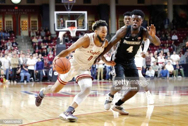 Boston College guard Ky Bowman gets past Providence Friars guard Maliek White during a game between the Boston College Eagles and the Providence...