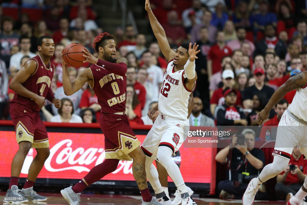 Boston College guard Ky Bowman (0) is guarded by NC State guard Allerik Freeman (12) during the game between the Boston College Eagles and the NC State Wolfpack at PNC Arena on February 20, 2018 in Raleigh, NC.