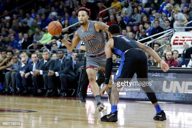 Boston College guard Ky Bowman passes guarded by Duke Blue Devils guard Trevon Duval during a game between the Boston College Eagles and the Duke...