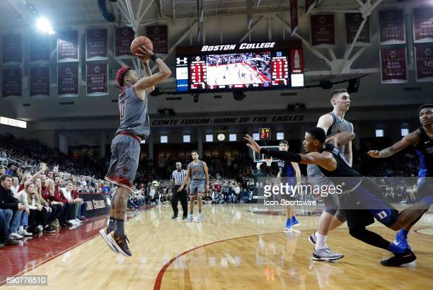 Boston College guard Ky Bowman shoots a three as Duke Blue Devils guard Trevon Duval fights through the pick of Boston College forward Nik Popovic...