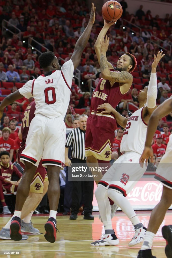 Boston College guard Ky Bowman (0) shoots the ball over NC State forward Abdul-Malik Abu (0) during the game between the Boston College Eagles and the NC State Wolfpack at PNC Arena on February 20, 2018 in Raleigh, NC. The Pack won 82-66.