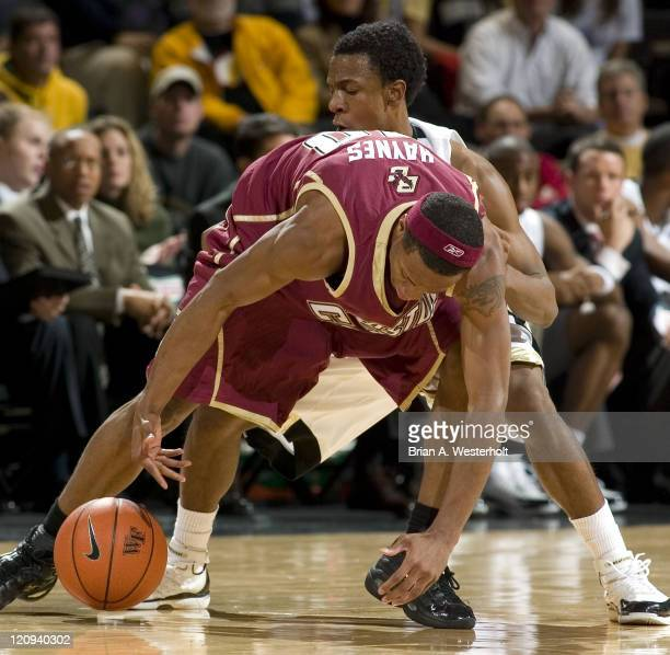 Boston College guard Marquez Haynes tries to keep the ball from wake Forest guard Ishmael Smith during first half action at the LJVM Coliseum in...