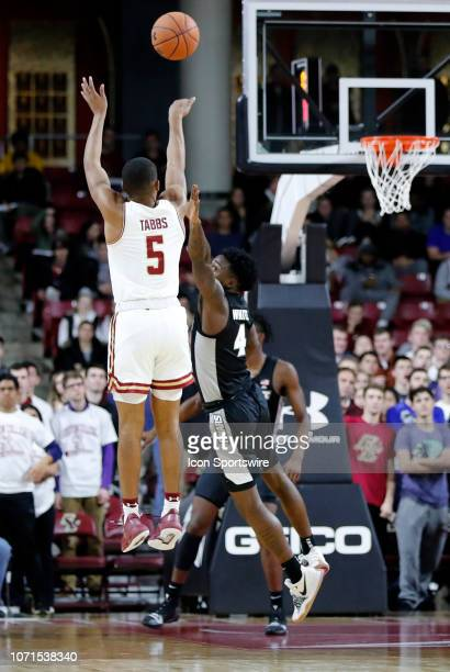 Boston College guard Winston Tabbs shoots over Providence Friars guard Maliek White during a game between the Boston College Eagles and the...