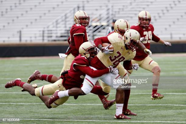Boston College maroon defensive back Timi Tijani catches Boston College gold fullback Richard Wilson during the Jay McGillis Spring Game on April 22...
