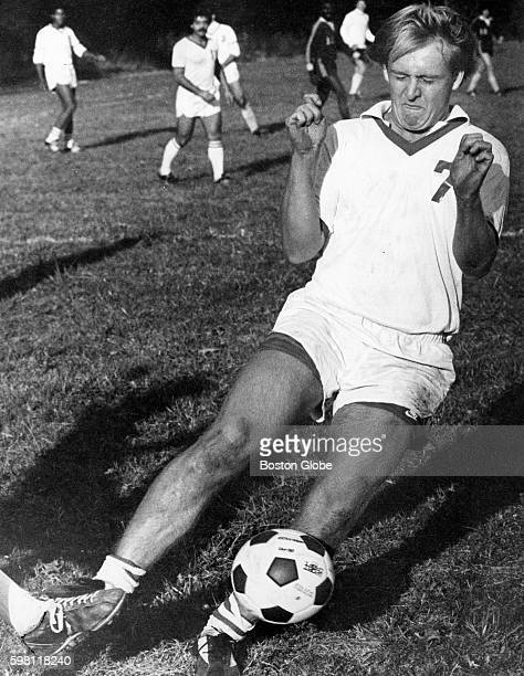 Boston College player kicks the ball away from Curry College player Jeff Henel along the sideline during a game in Milton Mass on Oct 25 1978