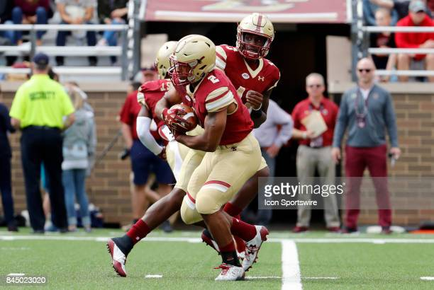 Boston College quarterback Anthony Brown hands off to Boston College running back AJ Dillon during an ACC matchup between the Boston College Eagles...