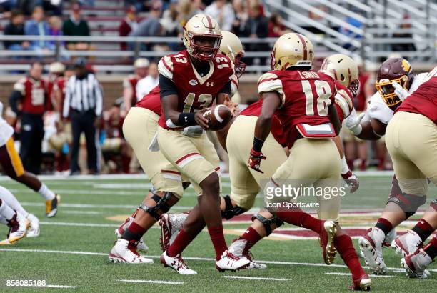 Boston College quarterback Anthony Brown hands off to Boston College wide receiver Thadd Smith during a game between the Boston College Eagles and...