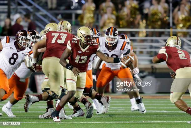 Boston College quarterback Anthony Brown hands off to Boston College running back AJ Dillon during a game between the Boston College Eagles and the...