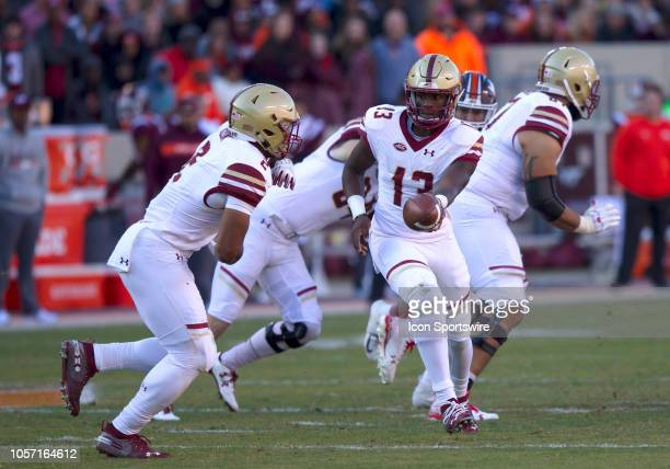 Boston College quarterback Anthony Brown prepares to hand the ball to running back AJ Dillon during a game between the Boston College Eagles and the...