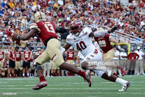 Boston College quarterback Anthony Brown stiff arms Temple University linebacker Todd Jones during a game between the Boston College Eagles and the...