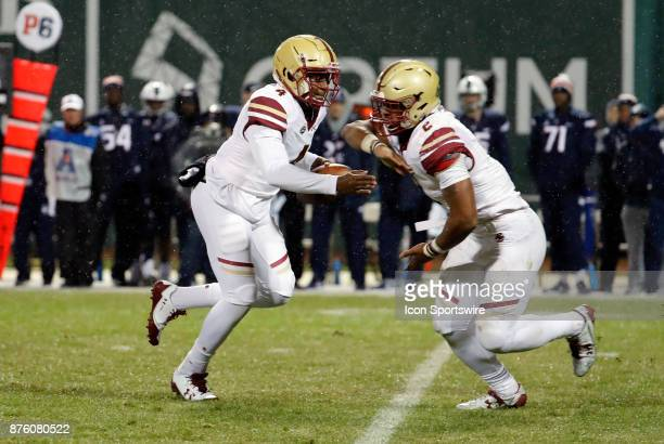 Boston College quarterback Darius Wade fakes the hand off to Boston College running back AJ Dillon during a game between the UCONN Huskies and the...