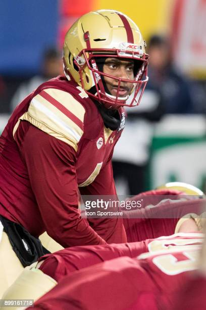 Boston College Quarterback Darius Wade looks over the Hawkeye defense during the first quarter of the New Era Pinstripe Bowl featuring the University...