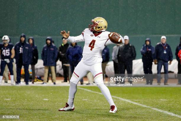 Boston College quarterback Darius Wade rears back to pass during a game between the UCONN Huskies and the Boston College Eagles on November 18 at...