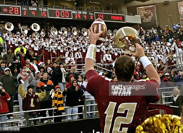 Boston College quarterback Matt Ryan applauds the fans as he runs off the field after the Eagles defeated the Hurricanes 28-14 for their first win...