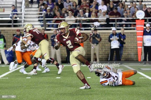 Boston College running back AJ Dillon breaks a tackle from Virginia Tech Defensive Back Mook Reynolds during a college football game between the...