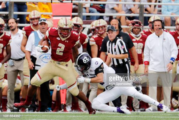 Boston College running back AJ Dillon escapes from Holy Cross defensive back Chris Riley during a game between the Boston College Eagles and the Holy...