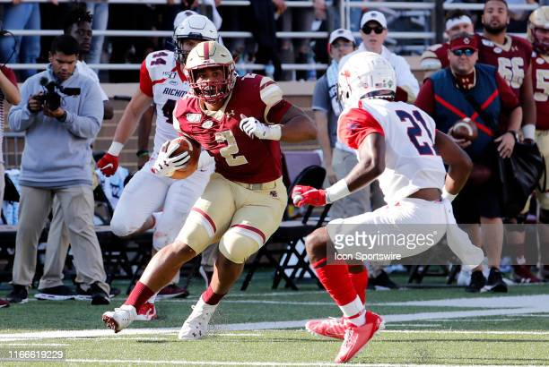 Boston College running back AJ Dillon puts a move on Richmond Spiders defensive back Trent Williams during a game between the Boston College Eagles...