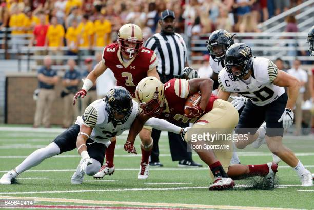 Boston College running back AJ Dillon runs into Wake Forest defensive back Jessie Bates III and Wake Forest linebacker Grant Dawson during an ACC...