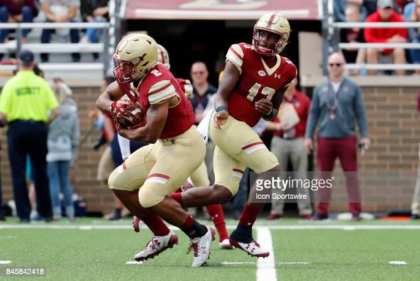 Boston College running back AJ Dillon takes the ball from Boston College quarterback Anthony Brown during an ACC matchup between the Boston College...