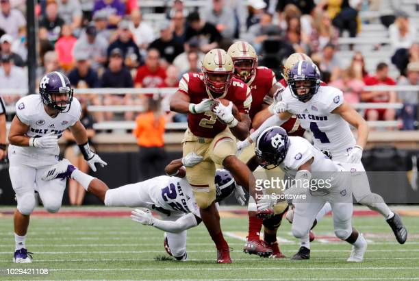 Boston College running back AJ Dillon tries to break free during a game between the Boston College Eagles and the Holy Cross Crusaders on September 8...